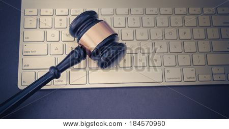 Gavel on keyboard, auction bid or legal law concept