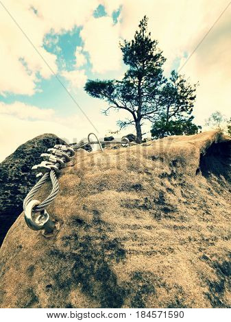 The End Knot  Of Steel Rope. Climbers Path Via Ferrata. Steel Bolt Anchor Eye