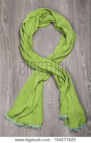 Green Scarf On Wooden Background