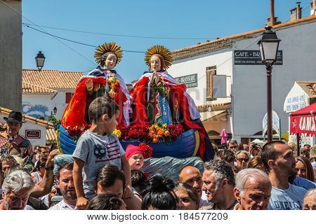 Saintes-Maries-de-la-Mer, France - May 25, 2015. Christians accompany two statues of the Holy Maries. Religious feast in honor of the Holy Maries in Provence. The concept of ethnographic tourism