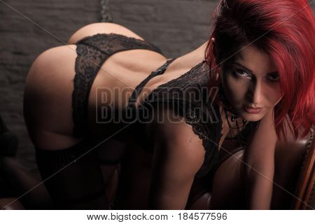 Prepare To Play In Love Games. Woman In Sexy Black Transperent Lingerie