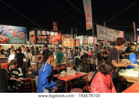 TAINAN TAIWAN - DECEMBER 11, 2016: Unidentified people visit Tainan flower night market. Tainan flower night market is the biggest night market in Tainan.