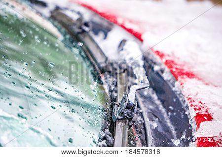 the snow and ice covered windshield wipers