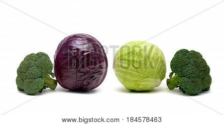 Cabbage of different sorts on a white background. Horizontal photo.
