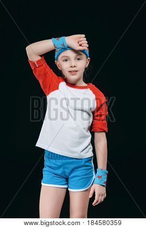 Tired Little Girl In Sportswear Wiping Sweat From Forehead, Activities For Children Concept
