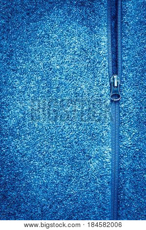 Blue Fleece Fabric With Zipper Background Texture. Copyspace And Vignette.