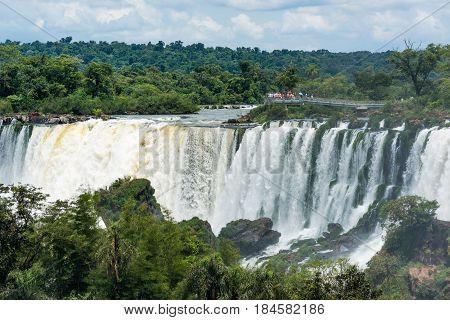 Spectators on observation deck watching Iguazu Falls