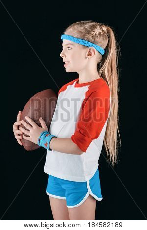 Little Sportive Girl With Rugby Ball Isolated On Black, Athletics Children Concept