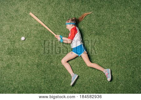 Top View Of Little Girl Pretending Playing Baseball On Grass, Athletics Children Concept