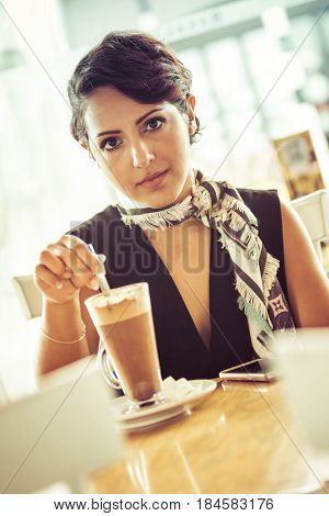 Young woman sitting coffee drink in cafe
