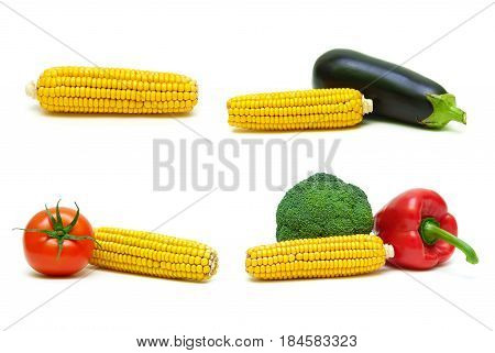 Corn and other vegetables on a white background. Horizontal photo.