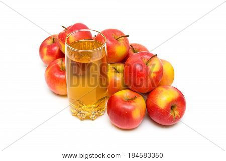 apple juice in glass and red apples on a white background. horizontal photo.