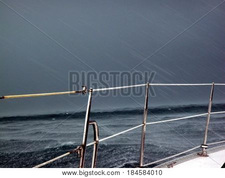 Storm squall and rain while sailing in the ocean