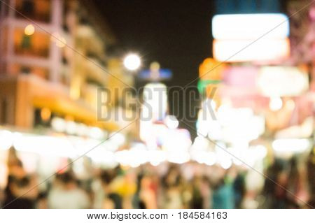 Blurred image of busy night life in the city. Defocused photo of night lights of the famous Ko San Road in Bangkok, Thailand.