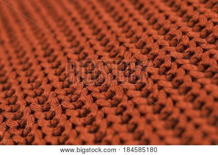 Texture of knitted brown fabric macro. A tissue sample