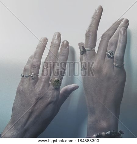Two female hands with rings on the fingers