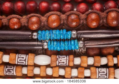 A group of Ethnic wooden bracelets and necklaces close-up