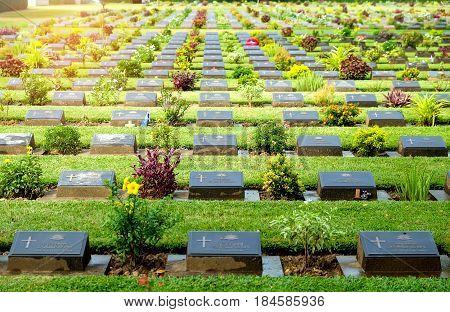 KANCHANABURI THAILAND - May 2017: Military coalition tomb tag in Kanchanaburi War Cemetery in Thailand.