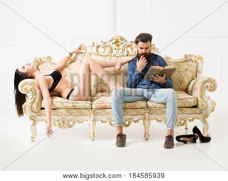 Man With Sexy Woman On Couch