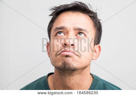 Crazy frown asian man on white background Upset feeling