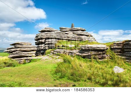 View of Bellever Tor in Dartmoor national park in southwest England. Copy space in blue sky.