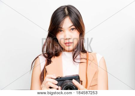 Portrait Of Asian Young Woman Taking Pictures On The White Background