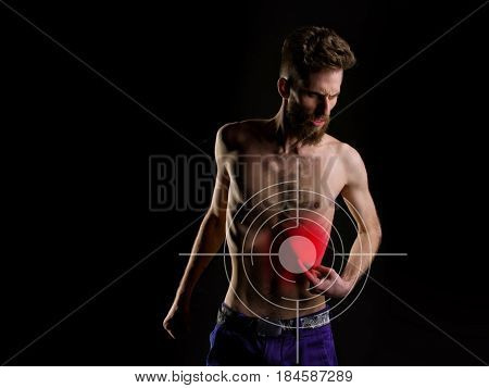 Unhappy Bearded Man Suffering From Pain In Stomach