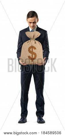 A businessman on white background holding a sack with a dollar sign printed on it. Banking and deposits. Investment and foreign exchange. Profitable business.