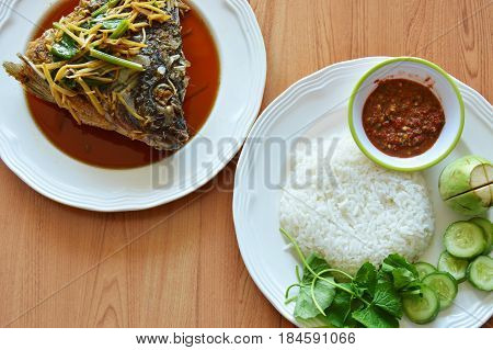 fried mango fish head dressing ginger soy sauce eat with rice and spicy shrimp paste sauce
