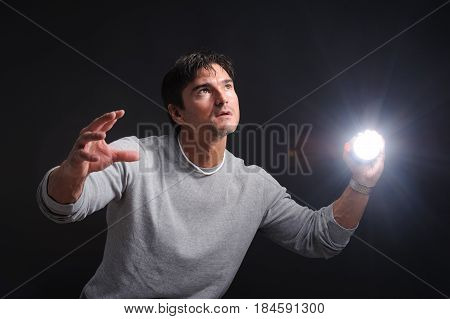 The spooky photo shows a man with a flashlight.