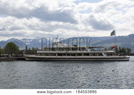 Rapperswil Switzerland - May 10 2016: MS Helvetia moored at the ferry terminal by the shore of Lake Zurich. The vessel was named Helvetia that is the female national personification of Switzerland