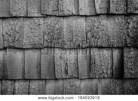 Worn down wooden roof background black and white