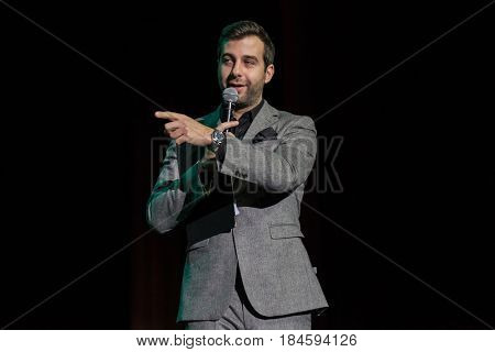 Moscow, Russia - April 24, 2017: Famous Russian showman Ivan Urgant performs at Synergy Global Forum at Crocus Expo Hall. This is one of the largest business forums with more than 5000 participants