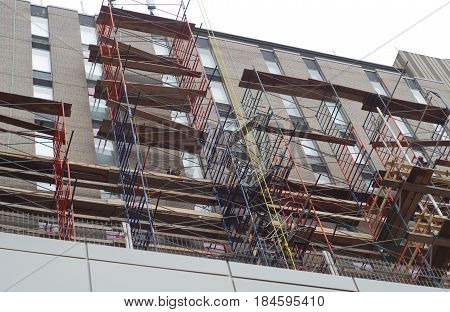 skyscraper scaffold building construction site renovation high facade windows