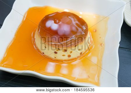 Creme caramel Caramel custard Custard pudding on wooden table
