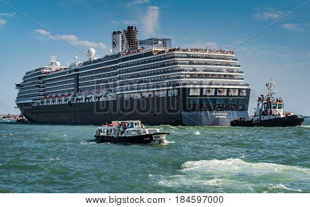 ms Oosterdam Holland America Line - Venice Italy - 04 August 2016: Cruise ship passing through the Grand Canal in Venice accompanied by a pilot boat and a water taxi.