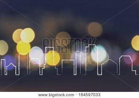 city skyline outline over night lights unfocused bokeh background