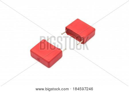 Red Metalized Polypropylene Film Capacitor, Isolated On White