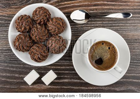 Round Chocolate Cakes In Saucer, Coffee, Lumpy Sugar And Spoon