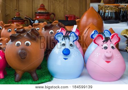 Adorable Ceramic Piggy Banks Hand Painted. Colorful piggy banks