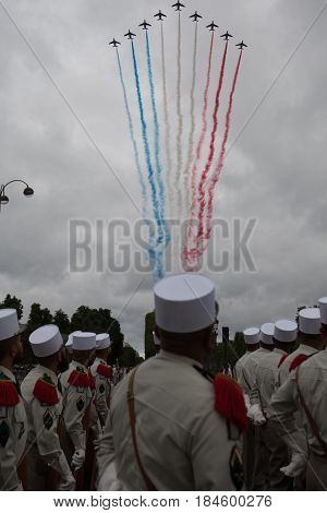 Paris. France. July 14 2012. Airplanes decorate the sky in the color of the flag of the French Republic during the parade on the Champs Elysees in Paris.