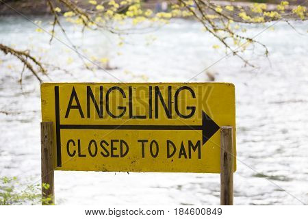 Yellow sign shows the regulations for the area that all angling and fishing is closed from that point to the Leaburg Dam.