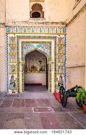 Colorful gate at Udaipur castle courtyard, India.