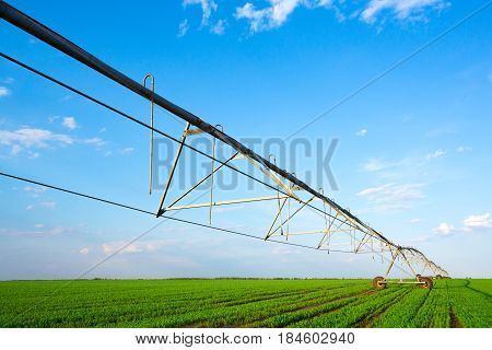 Irrigation system on wheels with blue sky