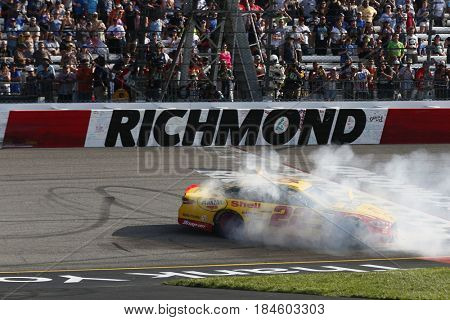 April 30, 2017 - Richmond, Virginia, USA: Joey Logano (22) celebrates after taking the checkered flag and winning the Toyota Owners 400 at Richmond International Speedway in Richmond, Virginia.