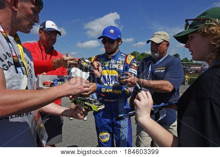 April 28, 2017 - Richmond, Virginia, USA: Chase Elliott (24) signs autographs for fans before practice for the Toyota Owners 400 at Richmond International Speedway in Richmond, Virginia.