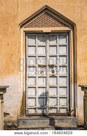 Ornamented old wooden door at Udaipur, India.
