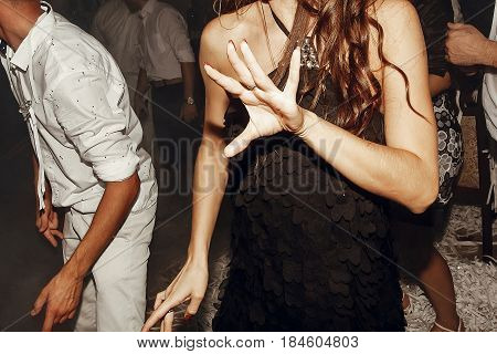 Guests Dancing At Wedding Party. Group Of Friends Having Fun At Disco In Light, Motion Moment. Weddi