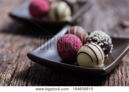 Truffles on a brown dish with wood background