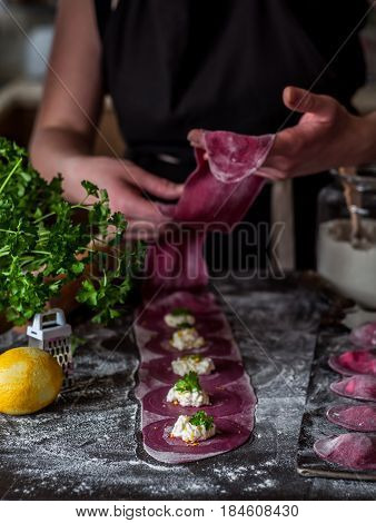 Female Making Beet Ravioli With Cheese